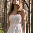 Girl in a dress in a forest — Stock Photo
