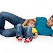 Dad and little daughter lying on the floor — Stock Photo #6447933