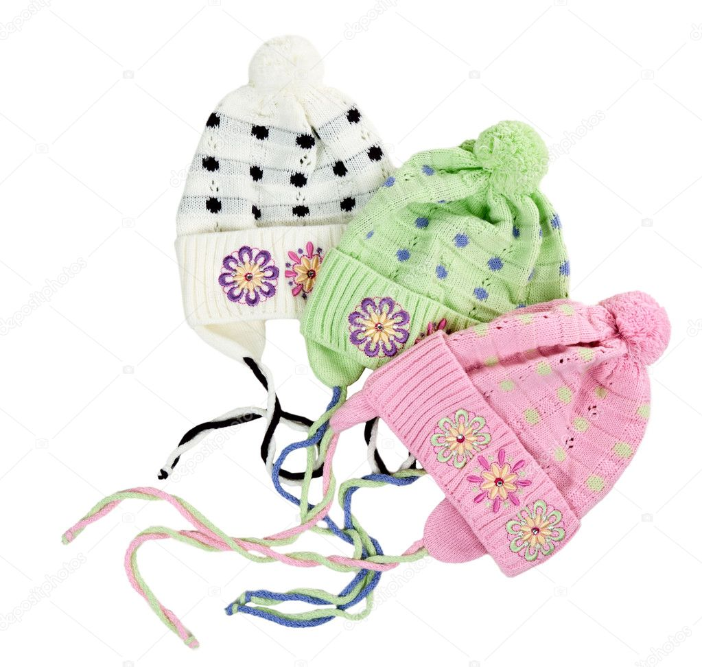 Three colored children's knitted hat with a flower pattern on a white background — Stock Photo #6447780