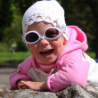 The image of a little girl in fashionable sunglasses — Stock Photo