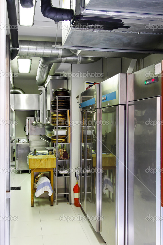 Professional kitchen interior with equipment and refrigerators — Stock Photo #5457318