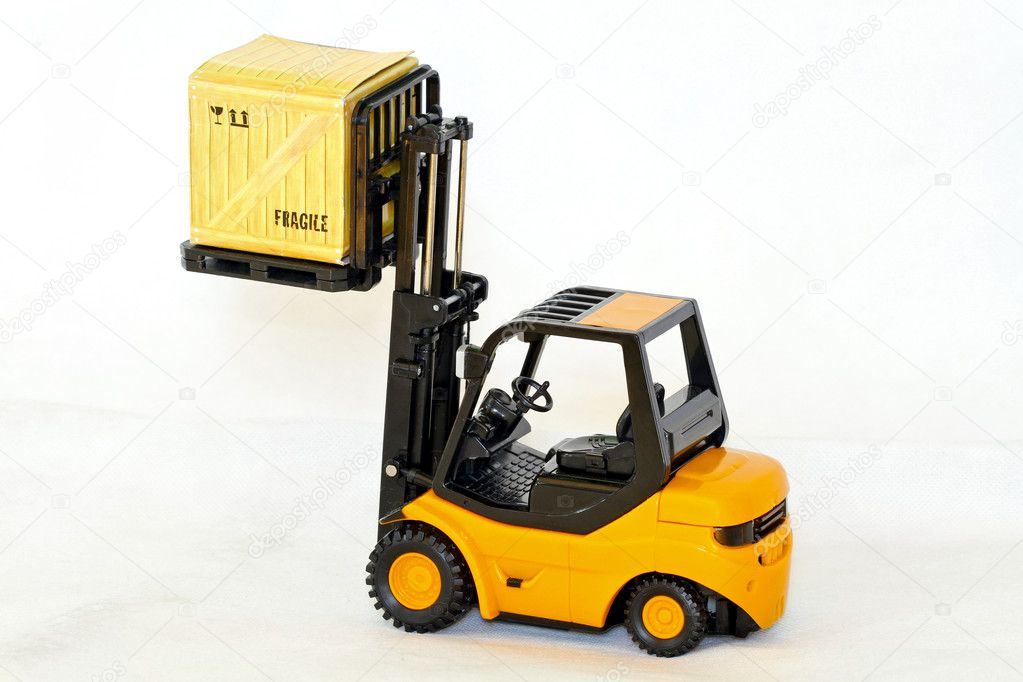 Small forklift vehicle with loaded fragile crate — Stock Photo #5574266
