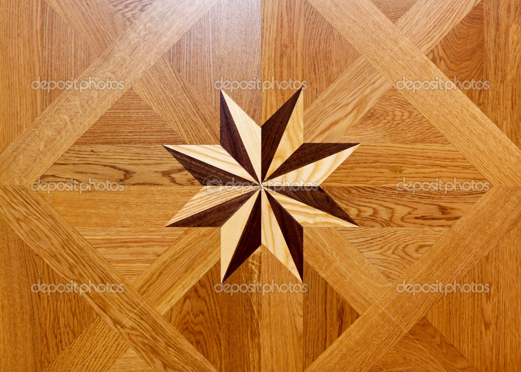 Wood marquetry star shape at floor parquet — Stock Photo #6680857