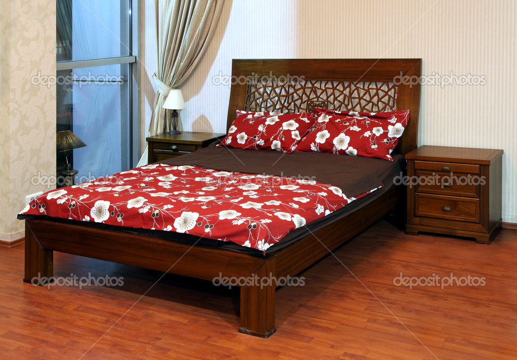 Modern bedroom interior with dark wooden furniture  Stock Photo #6715953