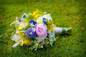 Wedding bouquet with wild flowers — Stock Photo