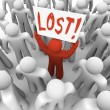 Person Holding Lost Sign in Crowd - Stock Photo