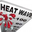 Heat Wave Temperatures on Thermometer - Stock Photo