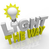 Light the Way - Leader with Bulb Lights Direction for Success — Stock Photo