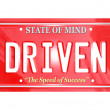 Driven Word on Red License Plate - Driving to Success - Stock Photo