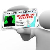 Licencja na sukces - sukces człowieka posiadającego specjalny znaczek — Zdjęcie stockowe