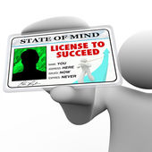 License to Succeed - Successful Man Holding Special Badge — Stock Photo