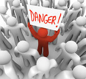 Danger - Person Holding Sign to Warn or Alert Others — Stock Photo