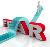 Conquering Your Fears - Jumping Over Word to Beat Fear — Stock Photo