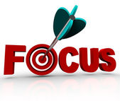 Focus Word with Arrow Hitting Target Bulls-Eye — Stock Photo