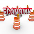 Royalty-Free Stock Photo: Economy Word in Hole Construction Barrels Recession