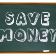 Save Money Words on Chalkboard Education Savings - Foto Stock