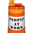 Royalty-Free Stock Photo: At Work Construction Orange Traffic Barrel