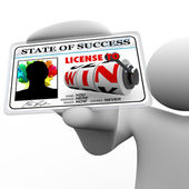 Man Holding License to Win as Identification Card for Access — Stock Photo