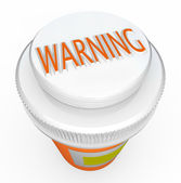 Warning - Medicine Bottle Cap Warns of Danger and Poisonous Pill — Stock Photo
