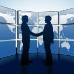 Business handshake world map monitors — Stock Vector