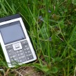 Mobile Phone in green grass — Stock Photo #5640311