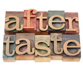 Aftertaste word in letterpress type — Stock Photo