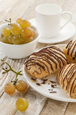 Chocolate croissants, grapes and coffee — Stock Photo
