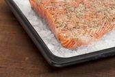 Baking salmon on rock salt — Stock Photo