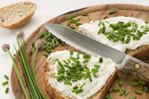 Bread with cream cheese and chives — Stock Photo