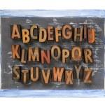 Letterpress alphabet on blackboard — Stock Photo
