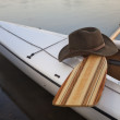 Paddle, hat and canoe — Stok fotoğraf