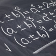 Mathematical equations on blackboard — 图库照片