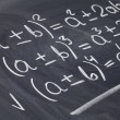 Mathematical equations on blackboard — Lizenzfreies Foto