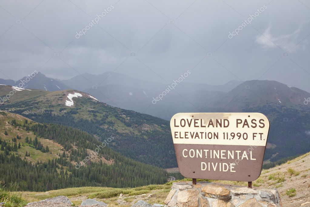 A sign at Loveland Pass and continental divide in Colorado Rocky Mountains  - a summer cloudy and foggy day  Stock Photo #6477380