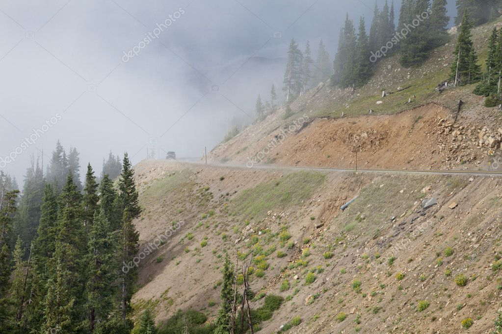 Mountain driving in Colorado Rocky Mountains  on highway 6 near continental divide and Loveland Pass - foggy day in summer — Stock Photo #6477472