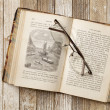 Antique book on a grunge table — Stock Photo