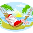 Santa claus in hammock relaxing in tropical beach - Stock Photo