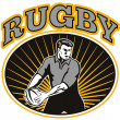 Rugby player passing ball - Stockfoto