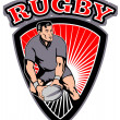 Rugby player passing ball shield - Stockfoto