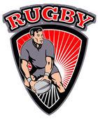 Gracz rugby, przechodzącą piłkę tarcza — Zdjęcie stockowe
