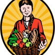 Female organic farmer crop harvest basket - Stock Photo
