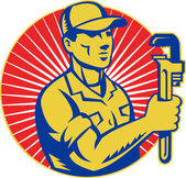 Plumber holding monkey wrench retro — 图库照片
