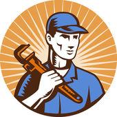 Plumber holding monkey wrench — Stock Photo