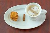 Cappuccino and cinnamon — Stock Photo