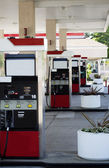 Four gas pump islands at station no cars — Stockfoto
