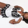 Young African American Woman schoolgirl outfit reclining — Stock Photo