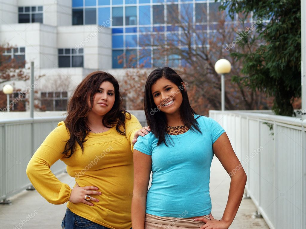 Two Latina Sisters Standing