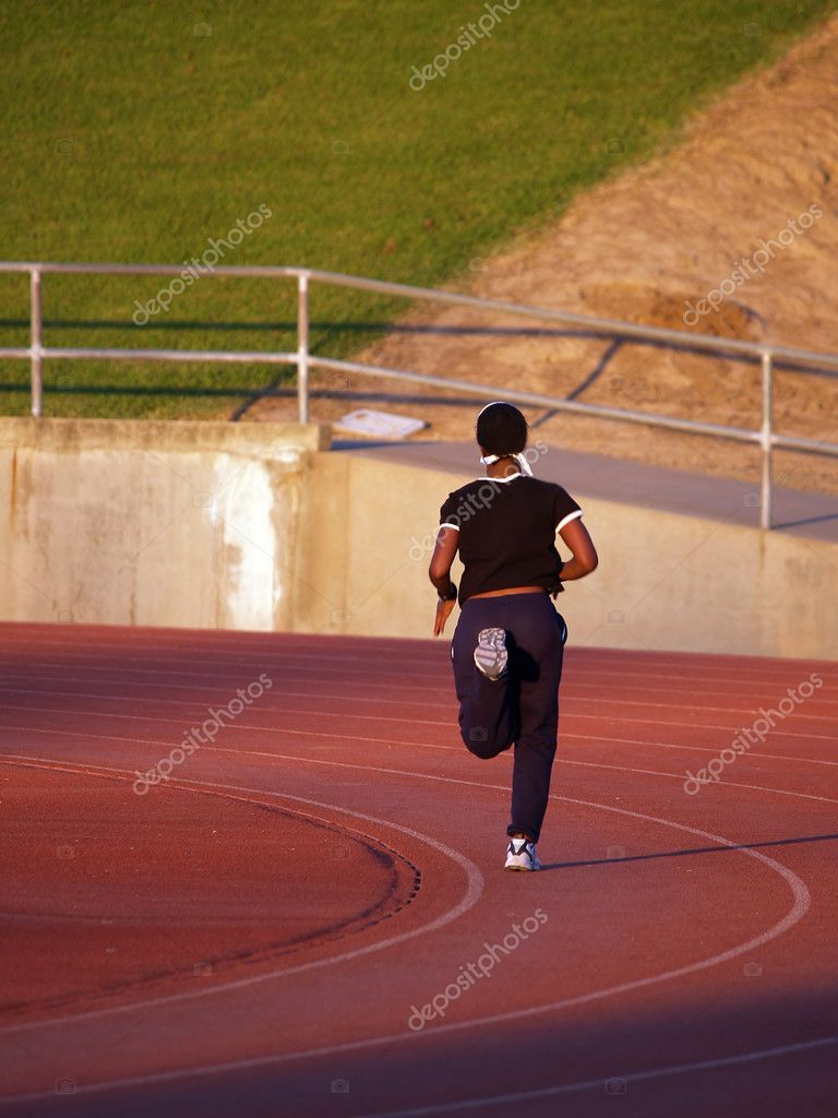 Young black woman running on track in sweats — Stock Photo #6537190