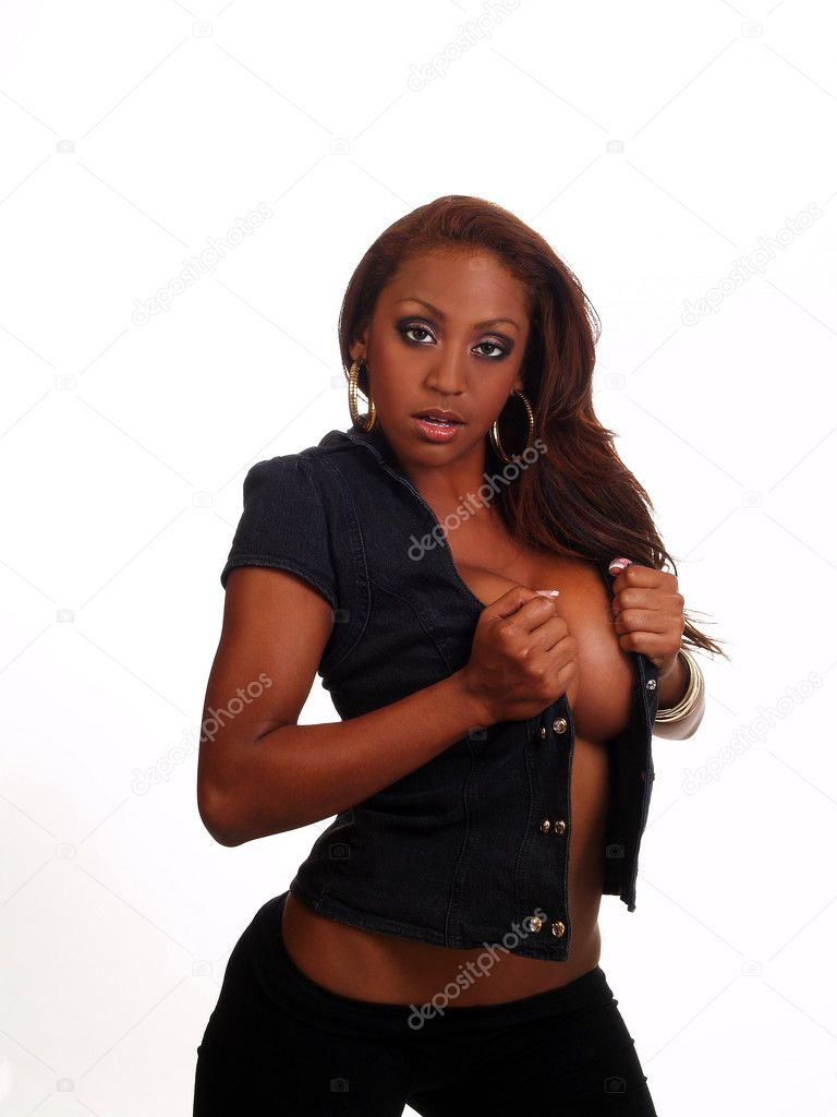 Attractive black woman standing with open vest showing cleavage — Stock Photo #6537192