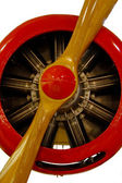 Red engine with wood propeller — Stock Photo